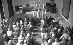 Audience anticipating the start of the ceremony in the Bethanienklooster in Amsterdam